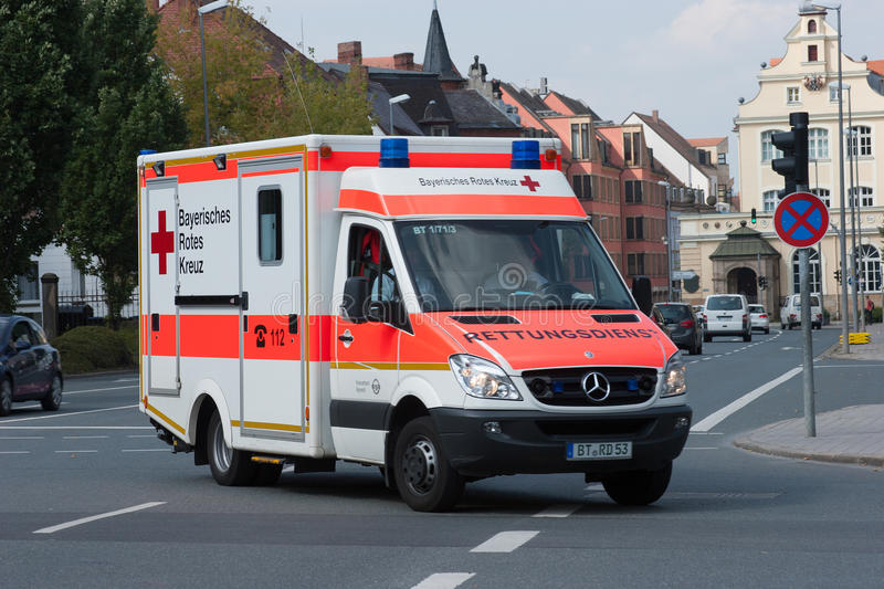 German ambulance car in use - Bavarian red cross. German ambulance in use. This Ambulance is part of the Bavarian Red Cross Germany royalty free stock photography