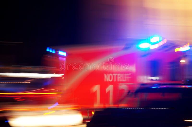 German ambulance driving fast at night stock photos