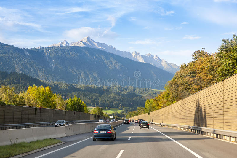 German Autobahn in Bavarian Alps. GERMANY - OCTOBER 18, 2016: View of driver looking at cars on German Autobahn in Bavarian Alps, October 18, 2016 royalty free stock image