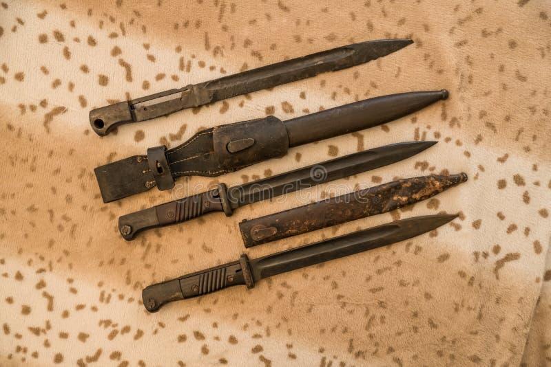 German bayonets. Various German bayonets with sheath on the table stock images