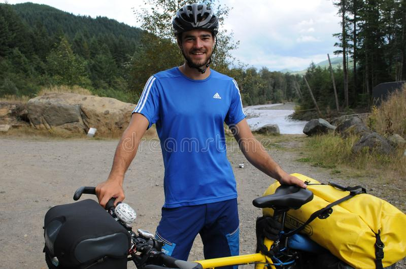 German biker from munchen Simon Piwowarsky in USA. GREENWATER RIVER /NEAR ENUMCLAW / WASHINGTON / USA./  SImon Piwowarsky short for Piwo riding bike on the dedge royalty free stock image
