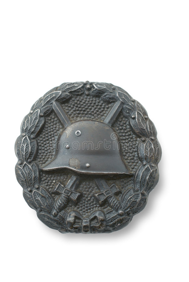 German breastplate (badge) for wounding at the WWI. In bronze. Established at 1918. Path at white background royalty free stock photos