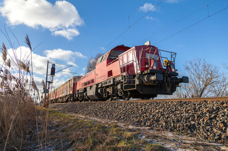 German cargo train drives on tracks. To freight yard stock photos