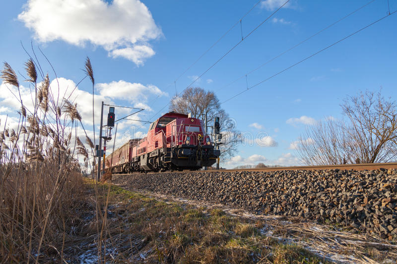 German cargo train drives on tracks. To freight yard stock photography