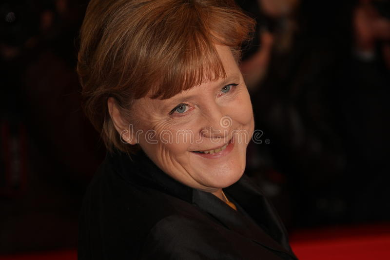 German Chancellor Angela Merkel. BERLIN, GERMANY - FEBRUARY 13: German Chancellor Angela Merkel attends the 'Pina' Premiere during of the 61st Berlin Film royalty free stock photography