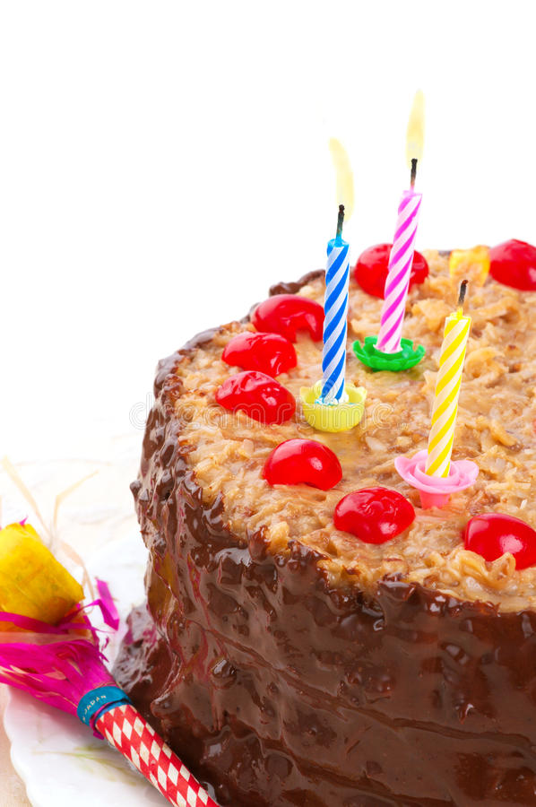 German Chocolate Birthday Cake With Lighted Candles Stock Image
