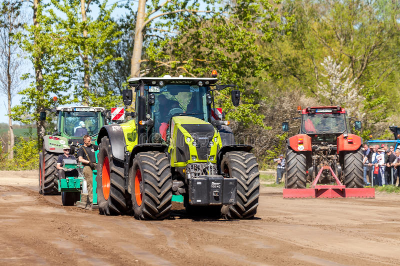 German claas axion tractor drives on track by a traktor pulling event. GRIMMEN/ GERMANY - MAY 5: german claas axion tractor drives on track by a traktor pulling royalty free stock photos