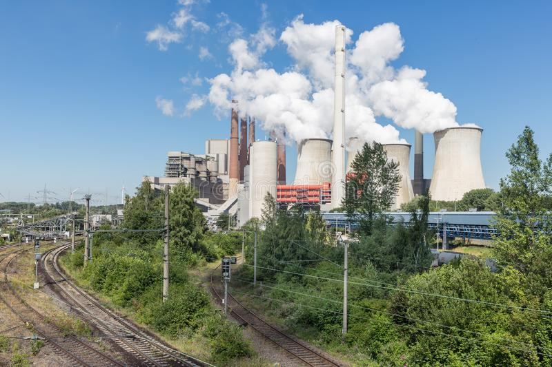 German Coal-fired power plant with railroad tracks near Garzweiler mine. Coal-fired power plant with railroad tracks near Garzweiler open pit mine in Germany royalty free stock photography
