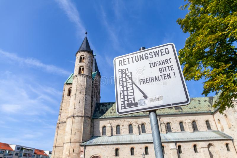 German escape route sign near a church royalty free stock photo