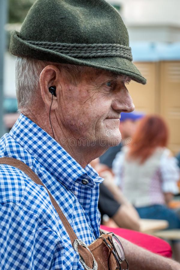 SANFORD, FLORIDA - OCT 14, 2019 - German Festival. A senior man dressed in traditional outfit enjoys the beer festival stock images