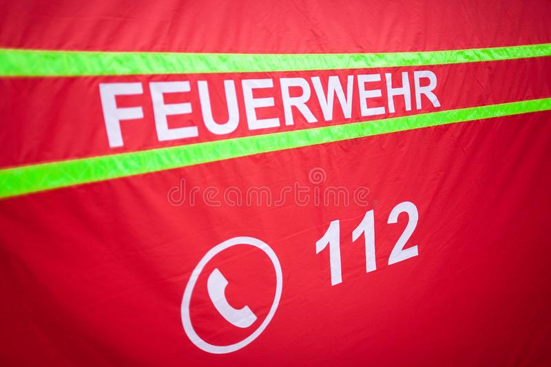 German fire department logo on a tent. The german word Feuerwehr means fire department royalty free stock photo
