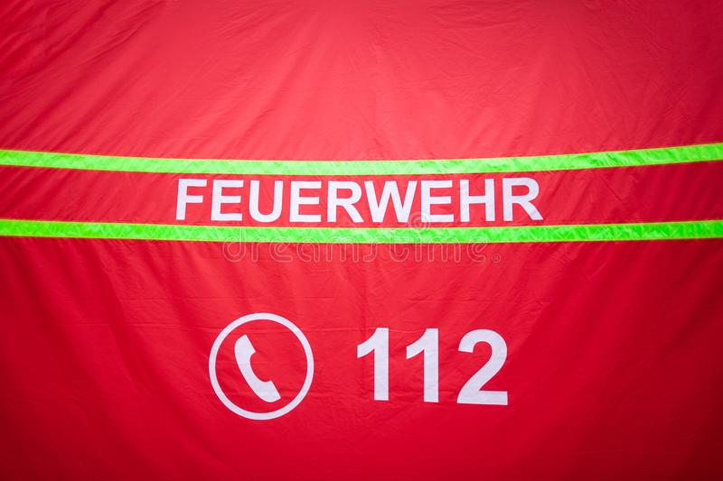 German fire department logo on a tent. The german word Feuerwehr means fire department royalty free stock photography