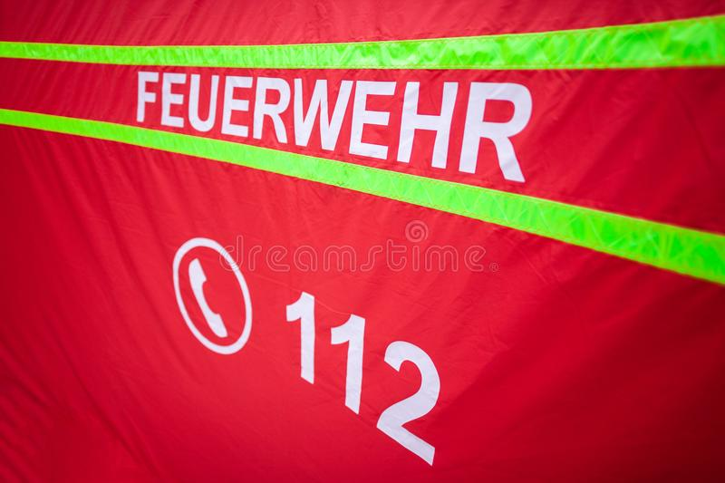 German fire department logo on a tent. The german word Feuerwehr means fire department stock photography