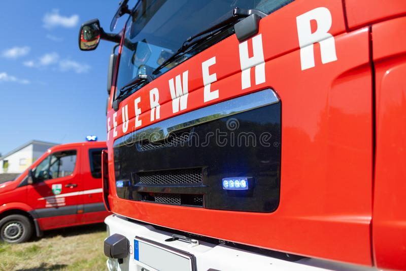 German fire engine stands on a deployment site. The german word Feuerwehr means fire department royalty free stock images