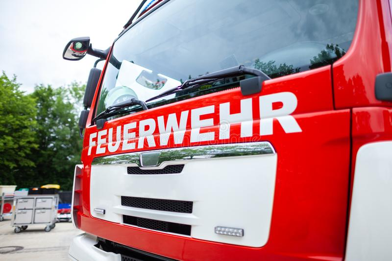 German fire engine stands on a deployment site. The german word Feuerwehr means fire department stock photography