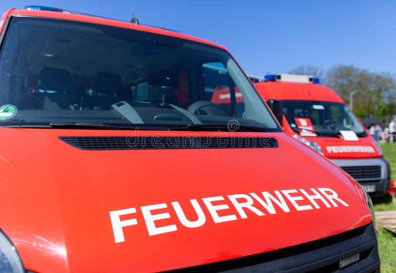 German fire engine stands on a deployment site. The german word Feuerwehr means fire department royalty free stock photo