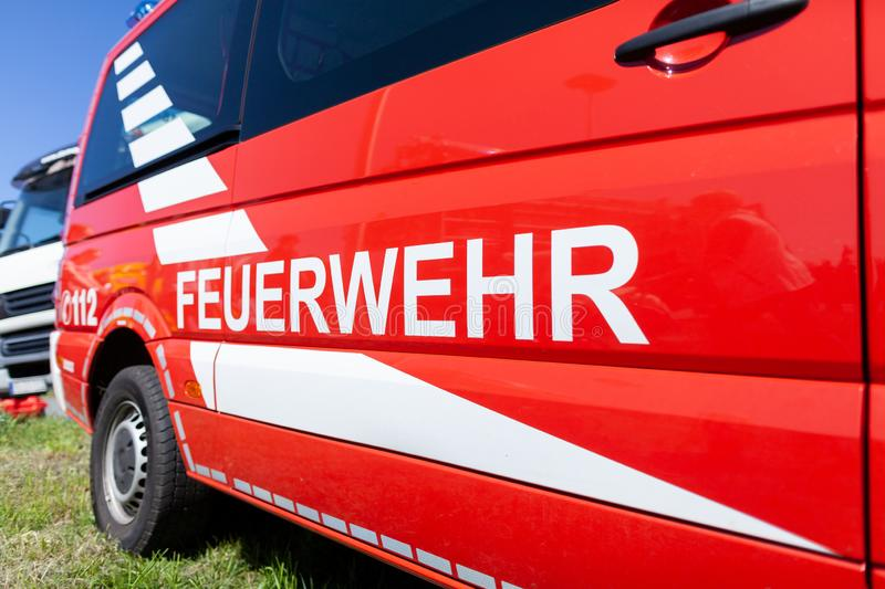 German fire engine stands on a deployment site. The german word Feuerwehr means fire department stock photo