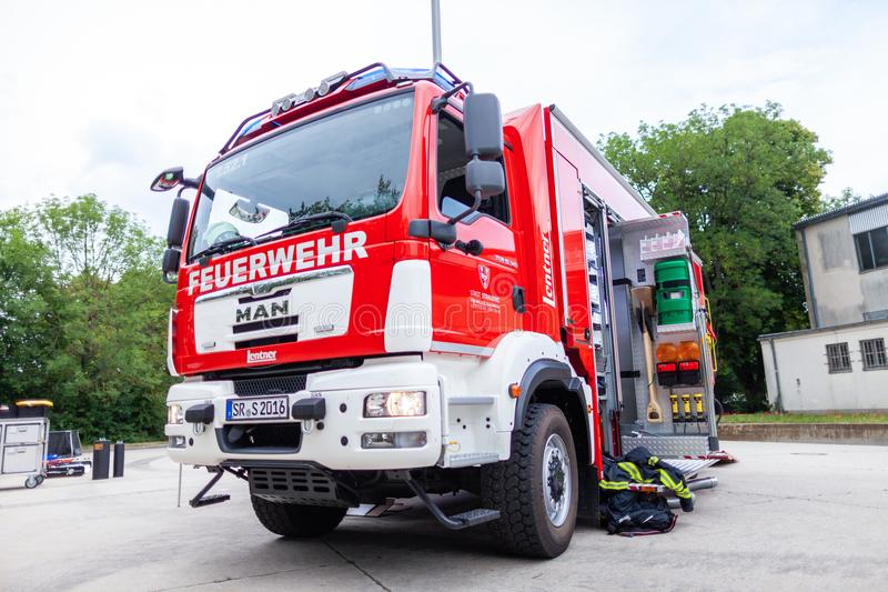 German fire engine stands on a platform on open day. FELDKIRCHEN / Germany - JUNE 9, 2018: German fire engine stands on a platform on open day. The german word stock photos