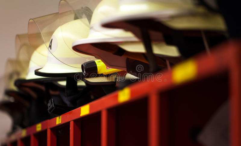 German fire helmets lined with lamp. German firefighters fire helmets lined royalty free stock photos