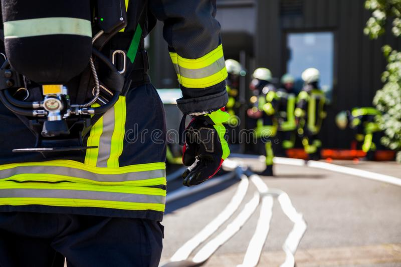 German fireman Feuerwehr stands near an accident. A german fireman Feuerwehr stands near an accident stock photo