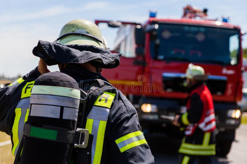 German fireman Feuerwehr stands near an accident royalty free stock photography