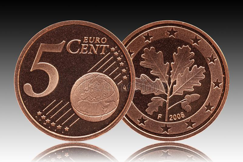 German five euro cent Germany coin, front side 5 and world globe, backside oak leaf stock photography
