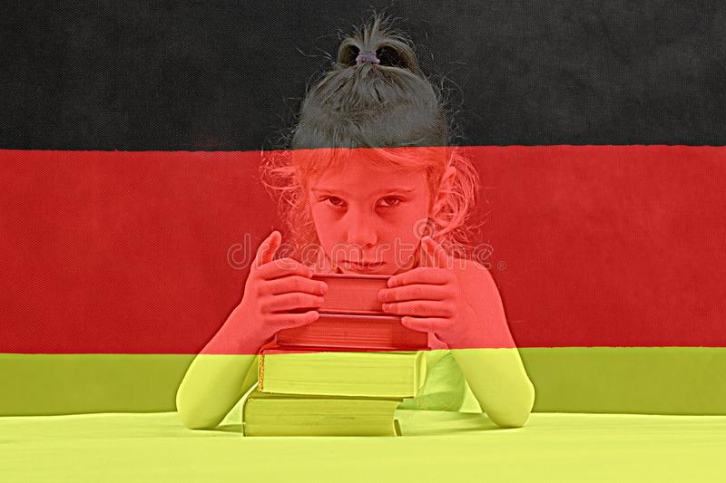 . German flag. blonde girl wants to learn German. double exposure stock images