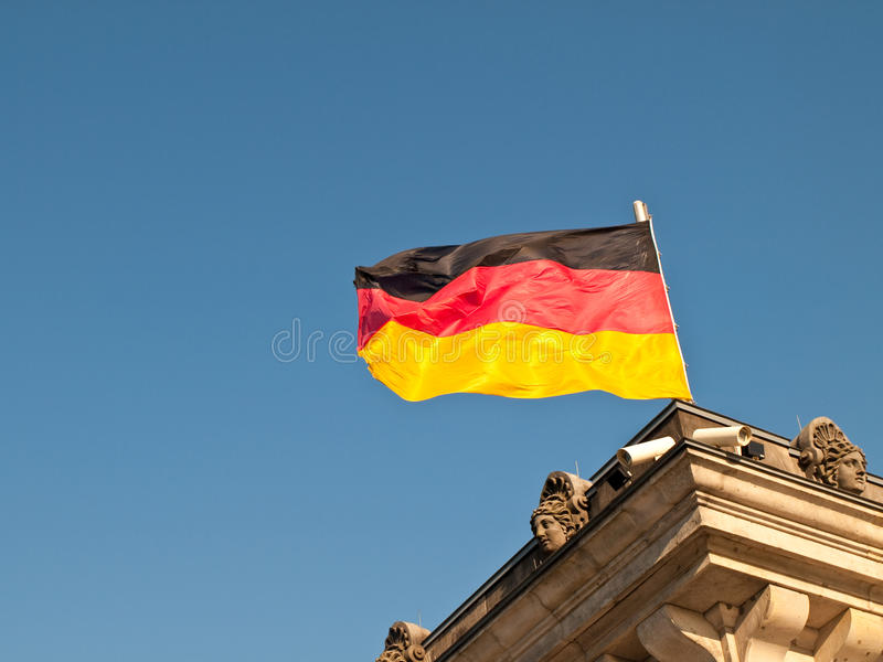 German Flag Flying over Reichstag stock photography