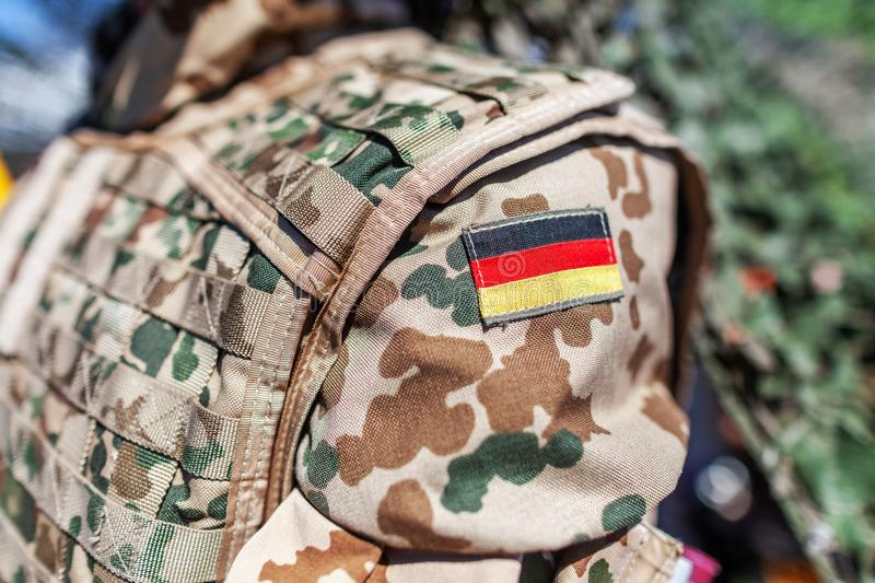 German flag on a german soldier desert uniform. A german flag on a german soldier desert uniform royalty free stock photography