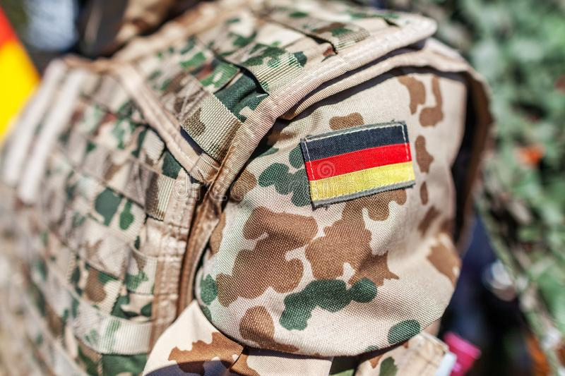 German flag on a german soldier desert uniform. A german flag on a german soldier desert uniform royalty free stock images