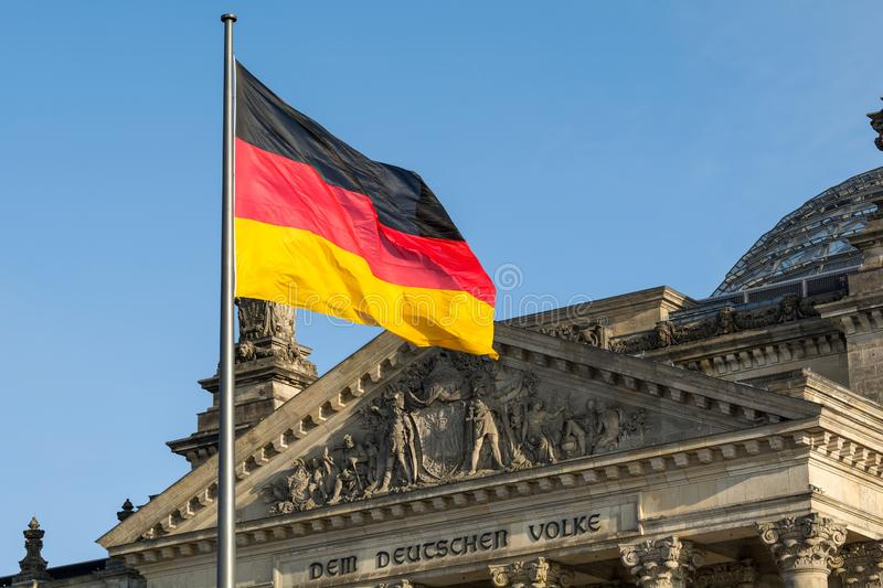 German flag waving front of Reichstag building. Berlin, Germany stock photography