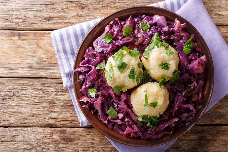 German food knodel potato dumplings and stewed red cabbage close. Up on a plate on the table. horizontal top view from above royalty free stock photos
