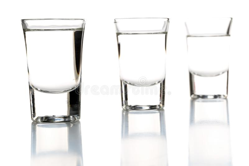 German hard liquor Korn Schnapps in shot glasses royalty free stock image
