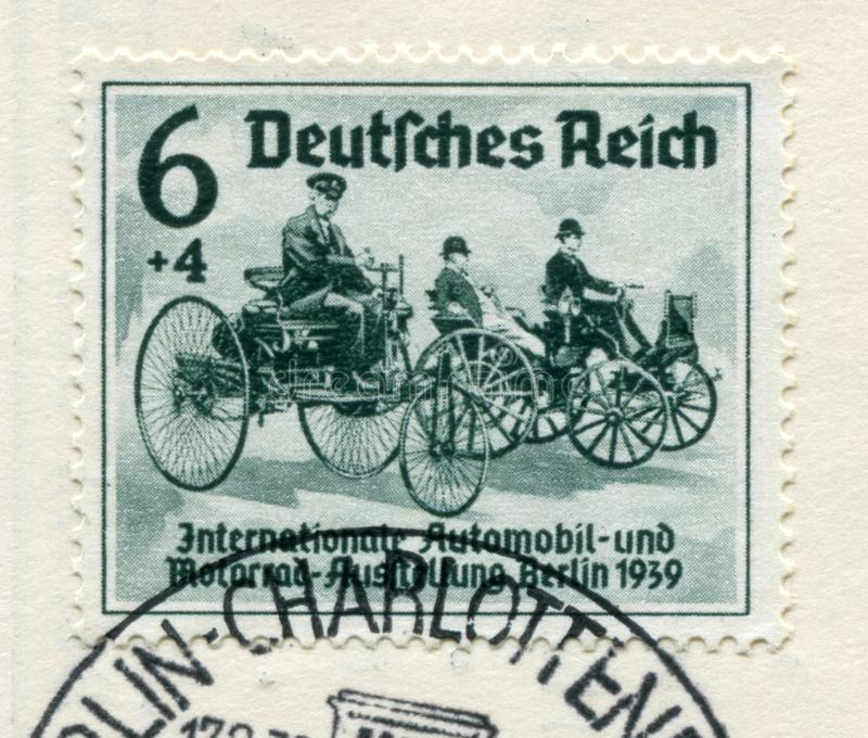 German historical stamp:  The first cars of Karl Benz and Gottlieb Daimler. `International auto and motor show in Berlin IAA 193 stock photo
