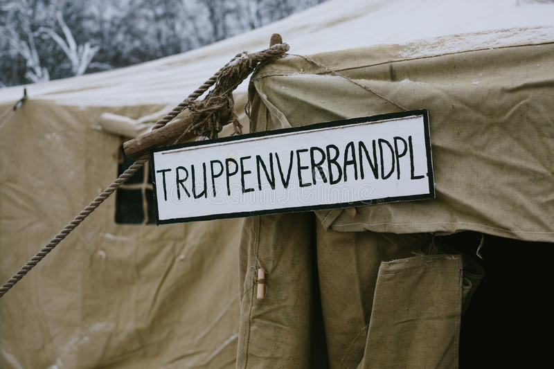 German inscription on a tent. Winter time photo stock image