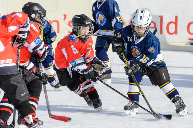 German kids playing ice hockey. Fuerstenfeldbruck, Bavaria, Germany - 06. February 2016: German Kids playing ice hockey. Age is about 10 years. Orange Player on stock images