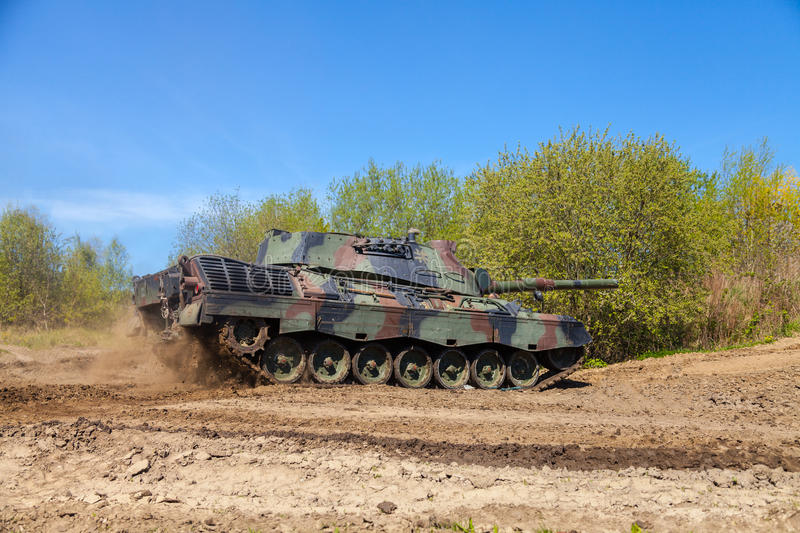German leopard 1 a 5 tank drives on track. GRIMMEN / GERMANY - MAY 5: german leopard 1 a 5 tank drives on track on a motortechnic festival on may 5, 2016 in stock image