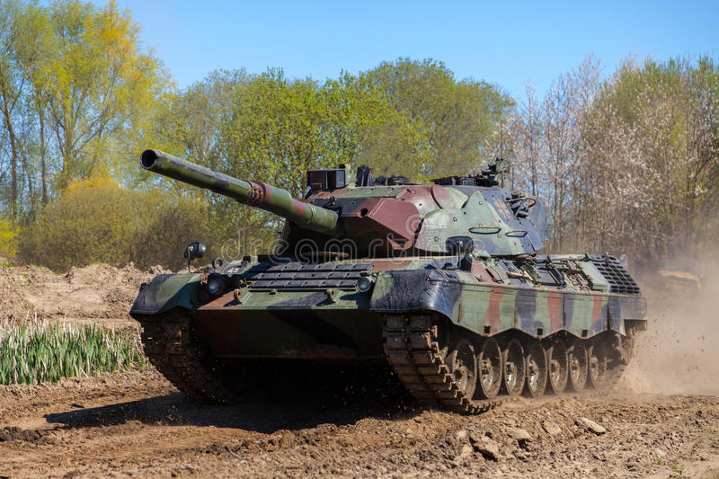 German leopard 1 a 5 tank drives on track. GRIMMEN / GERMANY - MAY 5: german leopard 1 a 5 tank drives on track on a motortechnic festival on may 5, 2016 in stock photography