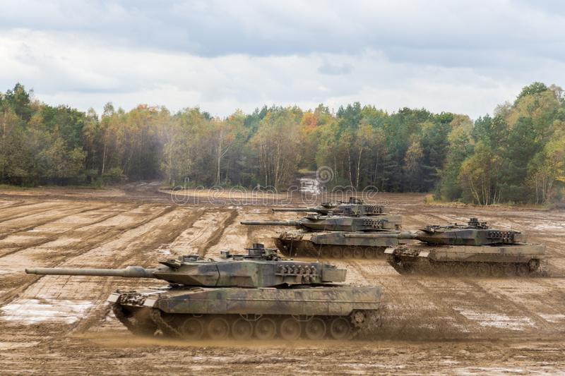 German main battle tanks drives on battlefield. Main battle tanks drives on battlefield royalty free stock photo