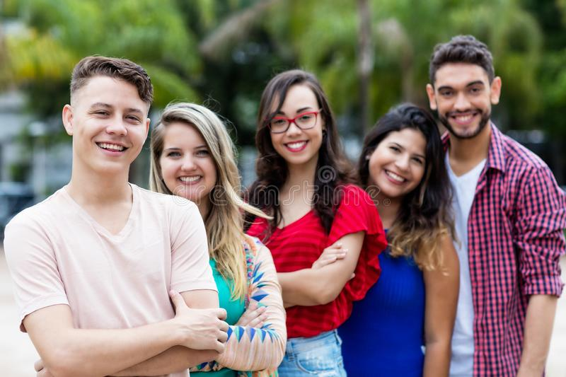 German man with male and female young adults in line royalty free stock image