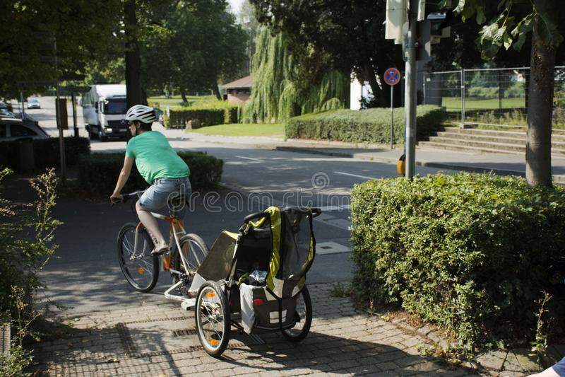 German mother people biking and children in stroller go to home royalty free stock photography
