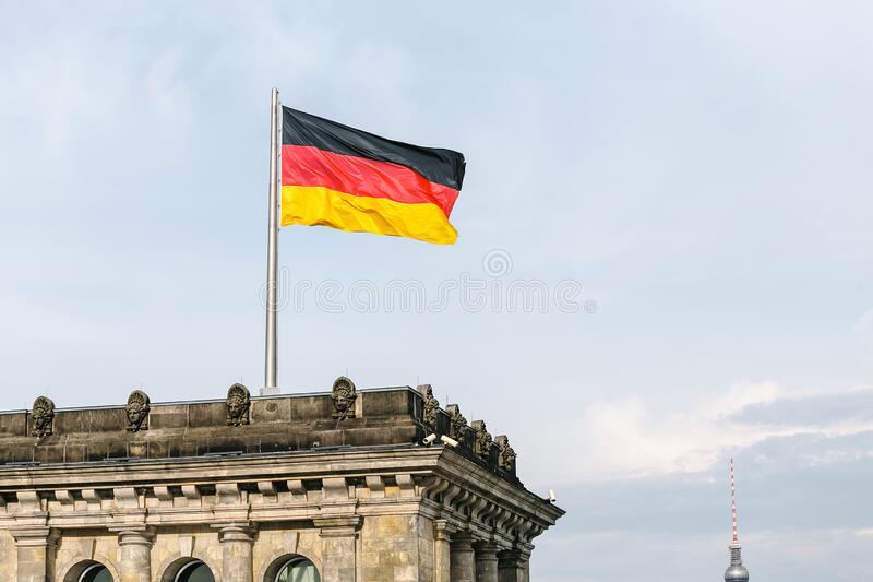 German national flag at the Government building in Berlin. German national flag at the Bundestag Government building in Berlin royalty free stock photo