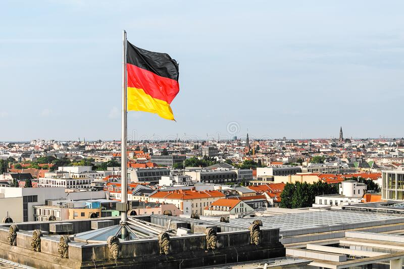 German national flag at the Government building in Berlin. German national flag at the Bundestag Government building in Berlin stock photos