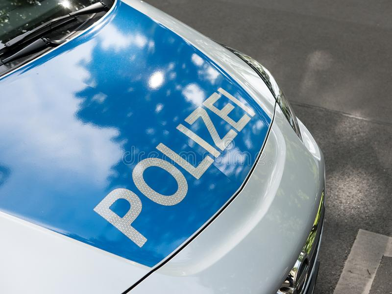 German News Concept: Blue Police Car. Selected Focus royalty free stock photo