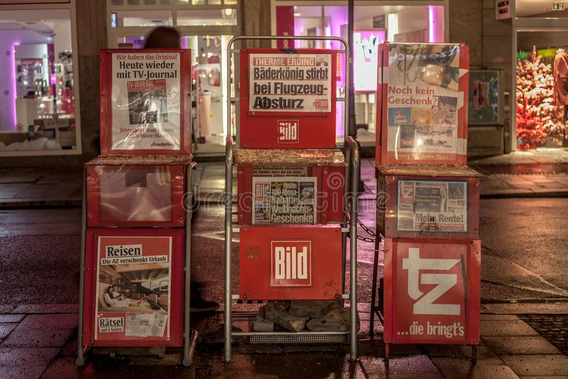 German newspaper Bild Zeitung for sale in the streets of Munich on stands, surrounded by TV Journal and ZT. German daily newspaper Bild Zeitung for sale on a stock images