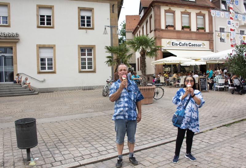 German old man and thai woman people show ice cream and eating at Speyer town. German old man and thai woman people show ice cream and eating after travel royalty free stock photo
