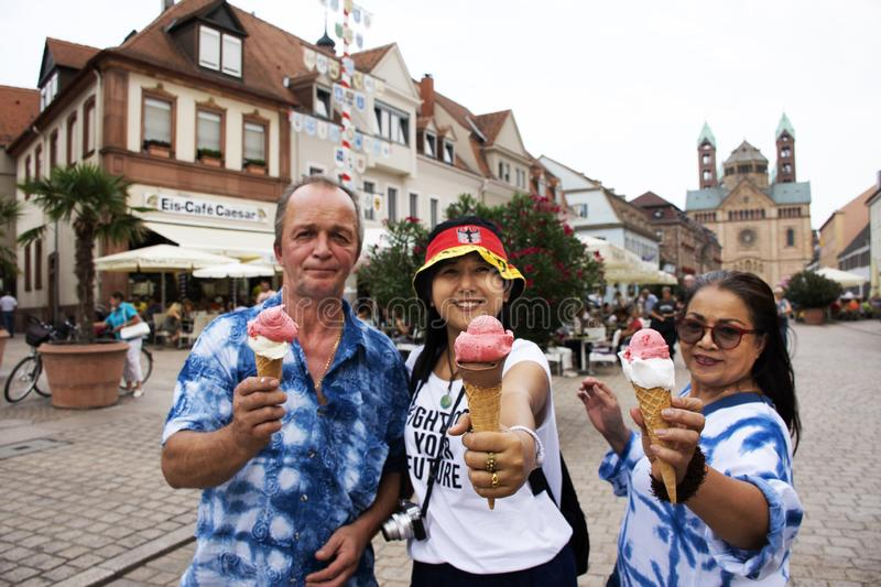 German old man and thai woman people show ice cream and eating at Speyer town. German old man and thai woman people show ice cream and eating after travel royalty free stock image