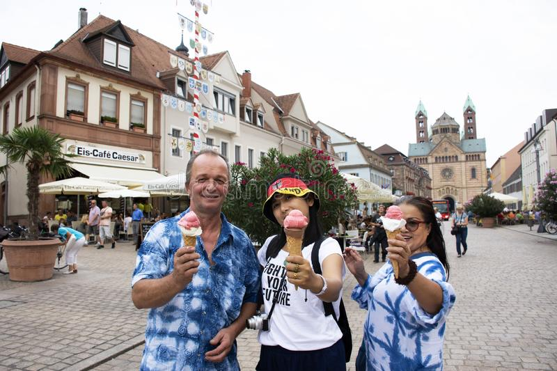 German old man and thai woman people show ice cream and eating at Speyer town. German old man and thai woman people show ice cream and eating after travel stock images