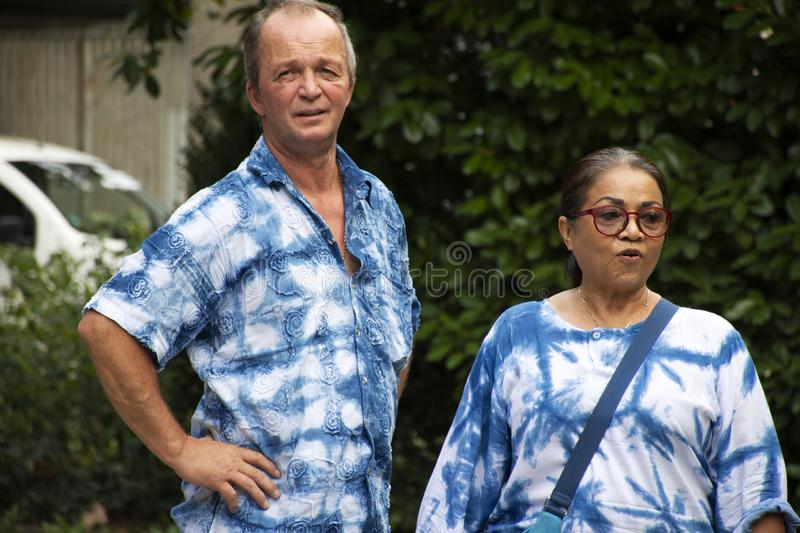 German old man and thai woman people travel and visit Speyer town. German old man and thai woman people travel and visit Speyer cathedral at Speyer town on stock photo