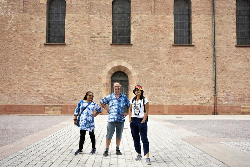 German old man and thai woman people travel and visit Speyer town. German old man and thai woman people travel and visit Speyer cathedral at Speyer town on stock photos